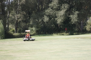 greenkeepers do their work at Corfu Golf Course